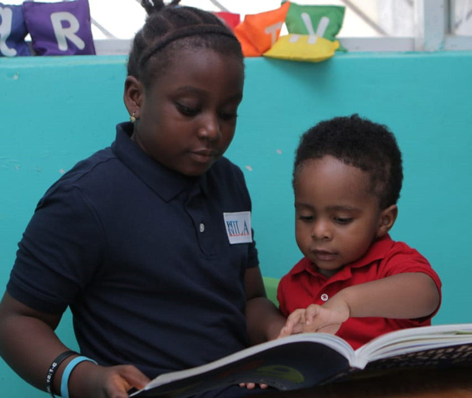 Two students reading a book